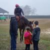 Paxton with his sister, Regan making a new friend. along with Brad Stauffer, head of Legacy Stable and exercise rider, Gene Tucker.